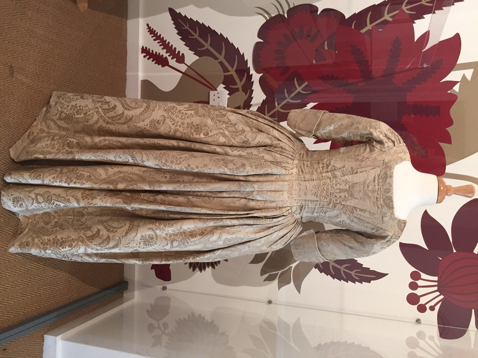 The back of the Lee Ault's silk gown on display